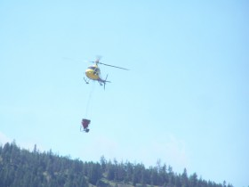 This helicopter dropped abucket of something on a field near the nicola river, we asume it to be bug spray