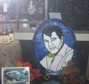 A leaded glass craft of Elvis appears in a down town shop. Photo KDG