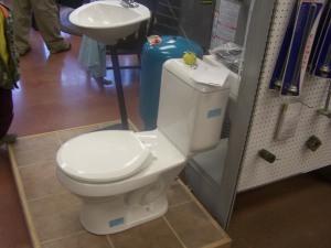 Dual flush toilet grand opening of plumbing shop
