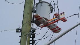 Model plane stuck in power line