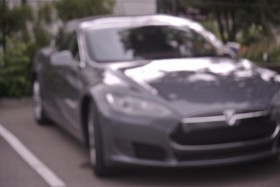Nofossil, a Tesla model S charging. The rear plate says nofossil Photo KDG