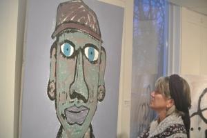 Local museum curator Jackie looks on Joel reis charactkure of his Dad, Photo KDG